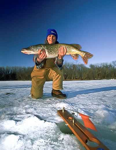 Wisconsin ice fishing is a winter tradition | Photo Credit: RJ & Linda Miller