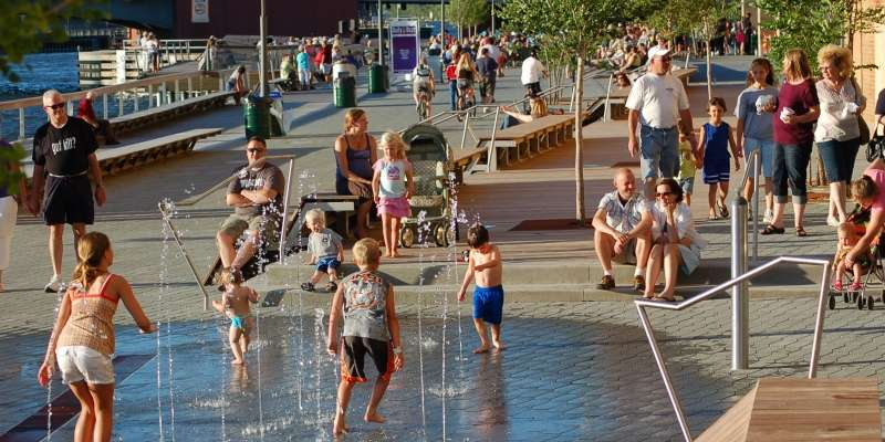Kids beat the July heat in the CityDeck Splashpad.