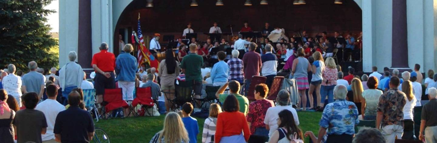 The audience listens to music performed in the historic bandshell at the Star Spangled Celebration.