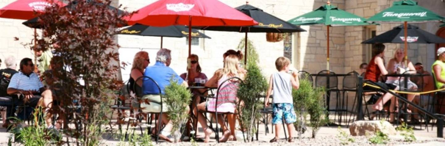Guests enjoy the nice weather on the outdoor patio at Trinity Restaurant and Hall.