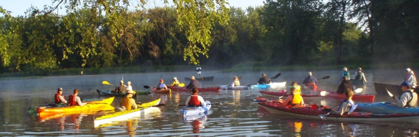 Kayakers gather in the calm water. Photo provided by: Sue Schultz.