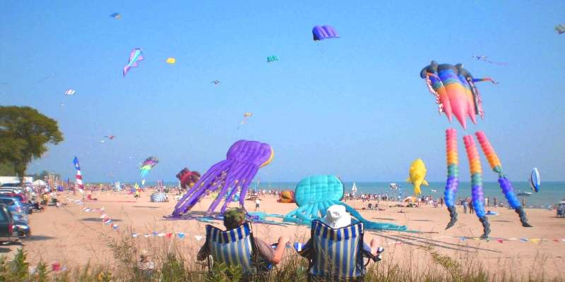A couple takes in the beauty of Kites Over Lake Michigan - one of the largest kite festivals in the Midwest.