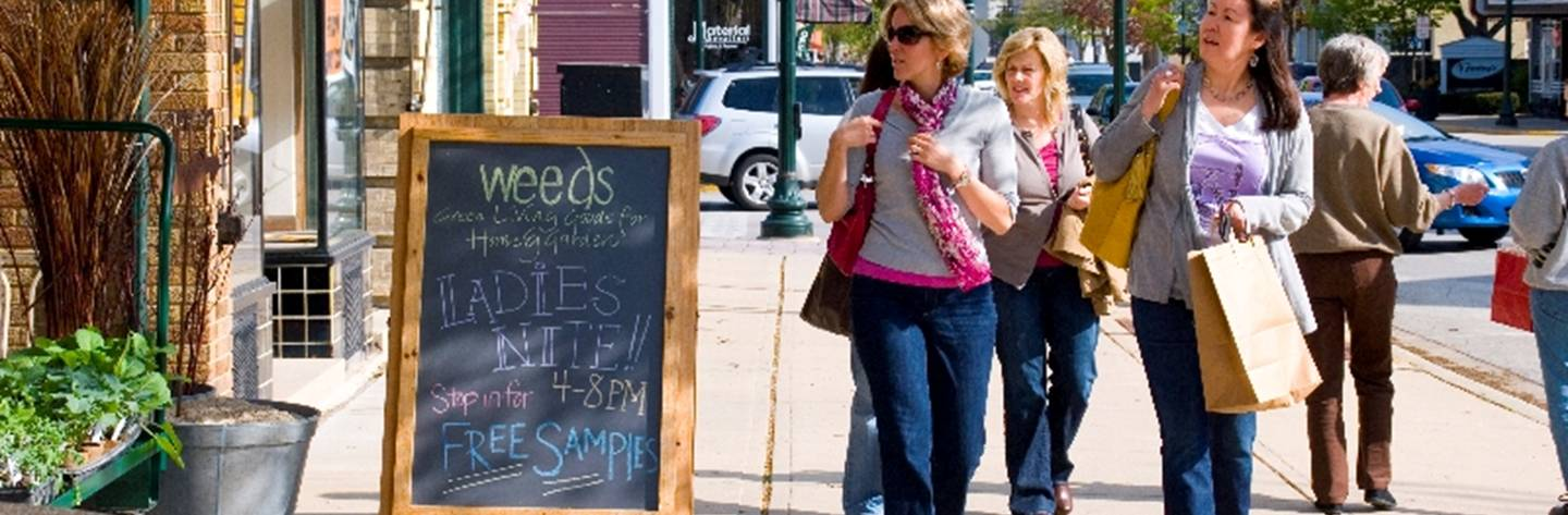 Curious women gather to check out the specials offered during Ladies Night Out.