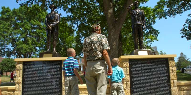 Visitors attend the Veteran's Honor Roll Memorial dedication on July 4, 2012.