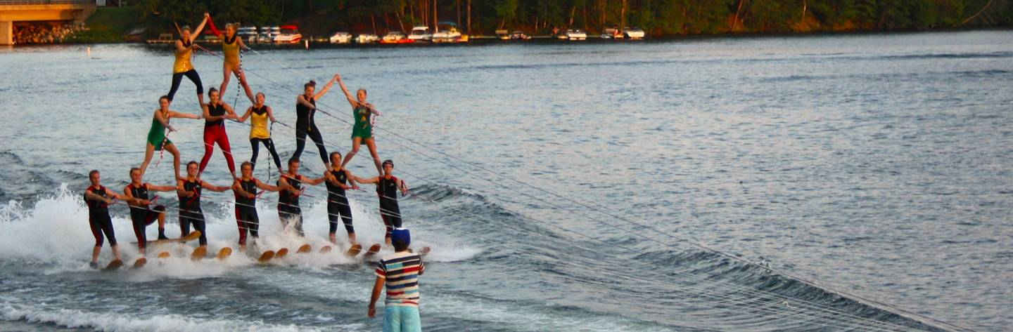The MinAqua Bats perform a human pyramid in a water ski show.