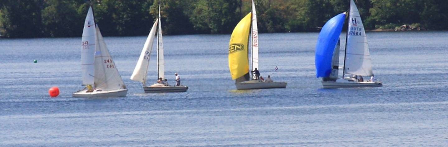 Sailboats glide across the calm, peaceful waters of Lake Wissota.