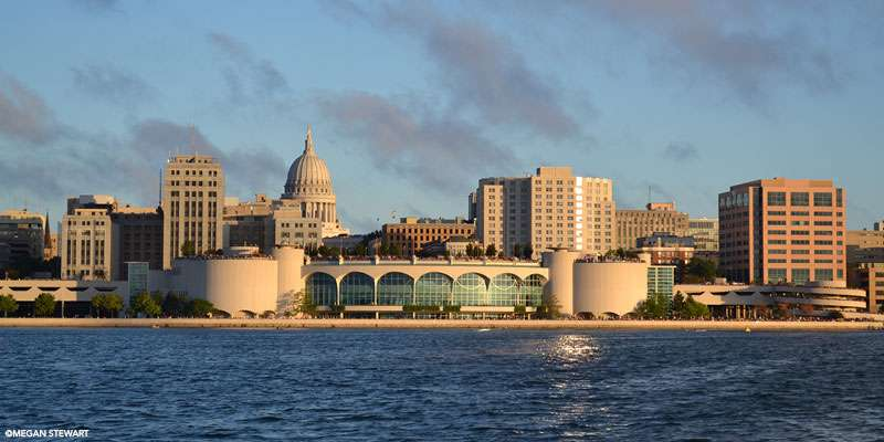 A stunning view across Lake Monona of the Monona Terrace Community and Convention Center and the Capitol.