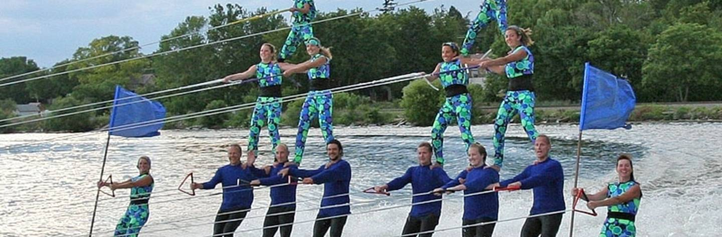 The Pewaukee Water Ski Team performs a 3-high human pyramid.