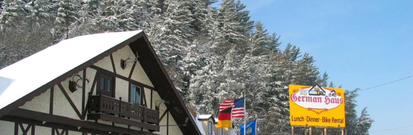 Snow covered trees create a stunning winter backdrop for the Target Bluff German Haus.