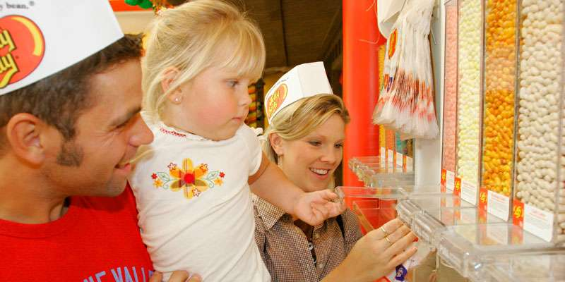 A young visitor is captivated by the colorful, sweet selection of over 100 different flavors of Jelly Belly beans.