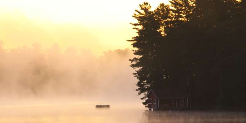 A beautiful sunrise over the lake and lifting fog make for a picturesque morning.