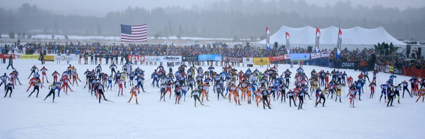 Skiers take off as spectators gather to cheer them on at the Birkie start line.