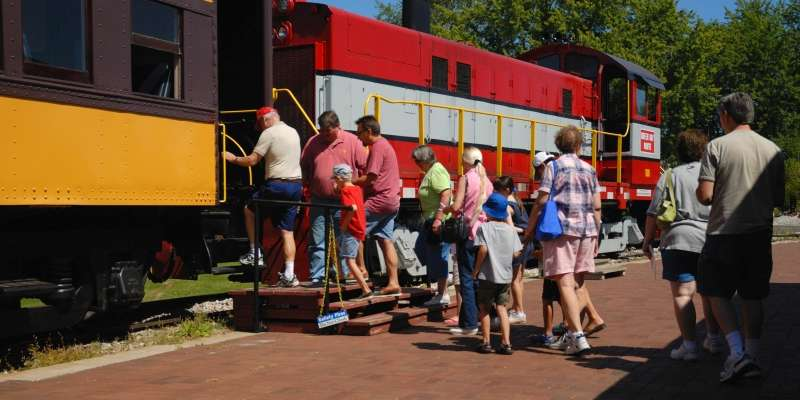 Visitors board a train at the National Railroad Museum.