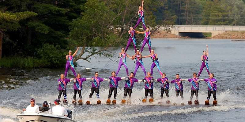 The Wisconsin Rapids Aqua Skiers perform a 4-high human pyramid on Lake Wazeecha.