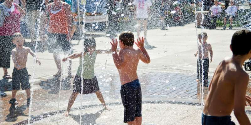 Kids cool off on a hot day in the fountains downtown. Photo: KT Elements