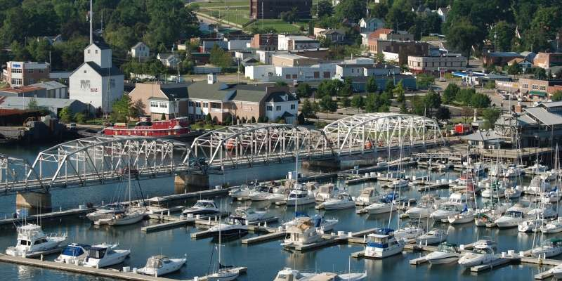An aerial photo captures Sturgeon Bay's beautiful waterfront with downtown in the background.