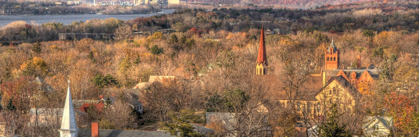 Church steeples emerge through the canopy of tree tops. Photo by Jeff Bucklew.