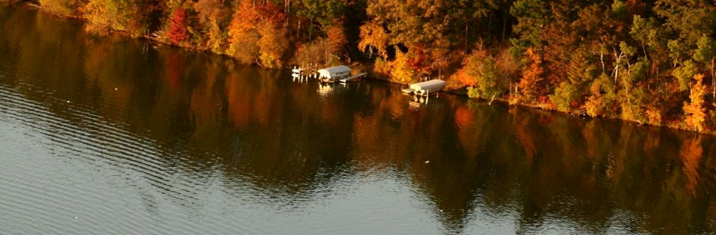 An aerial shot of the Lake Chetek shore line captures the stunning fall foliage. Photo by Tina Lockbaum.