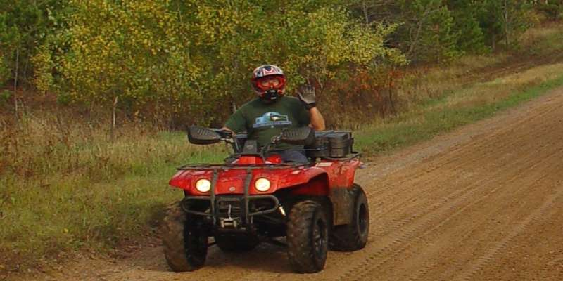 An ATV rider enjoys one of Marinette's outdoor recreational trails.