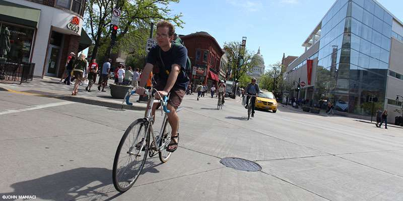 A biker enjoys biking down State Street where motorized traffic is restricted.