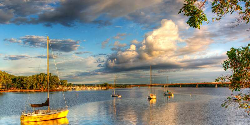 Sailboats drift in the calm water of the St. Croix River. Photo by Jeff Bucklew.