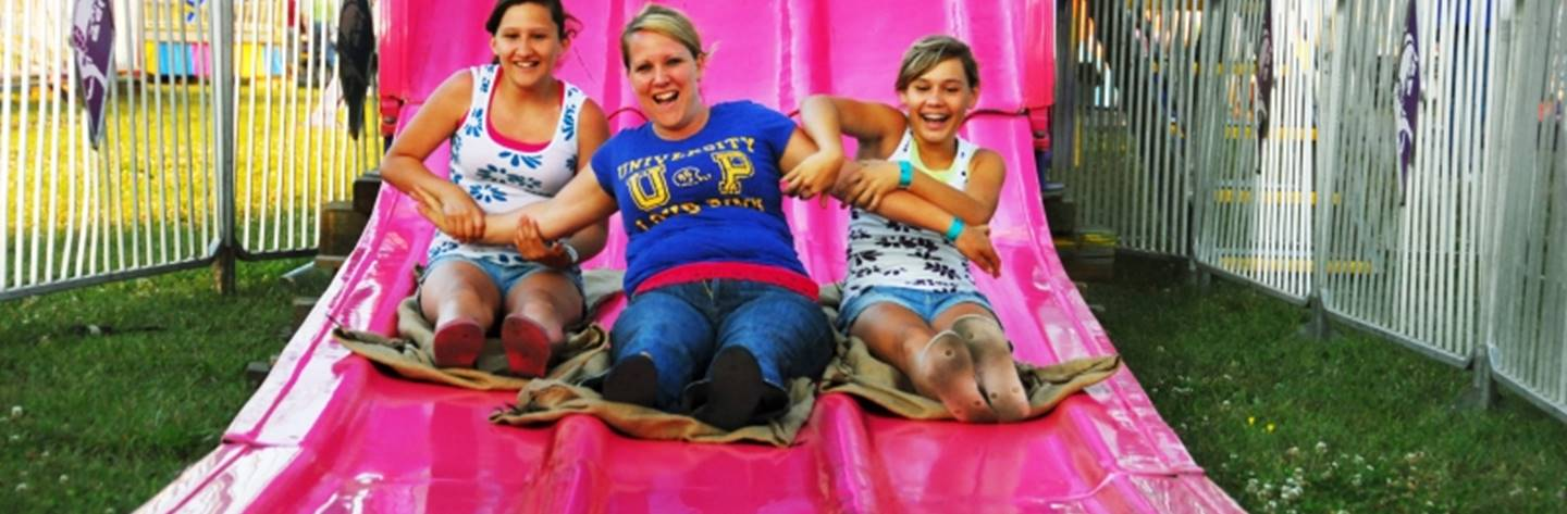 Riders enjoy a thrilling ride down a slide at the Northern Wisconsin State Fair.