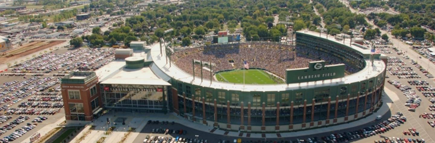 An aerial shot of Lambeau Field reveals the stadium filled to its brim with Packers fans on game day.