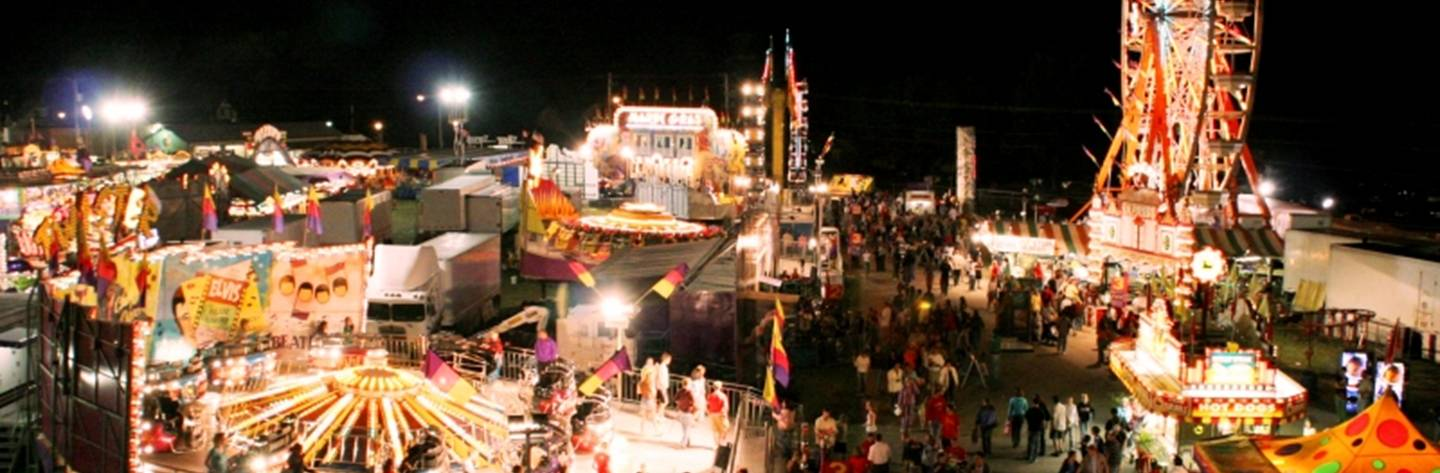 Bright carnival rides light up the night at the Walworth County Fair.