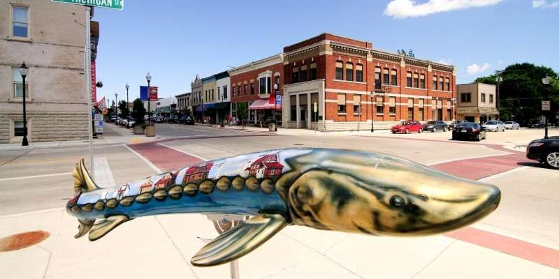 A statue of the prehistoric fish is painted with a waterfront scene. Photo: James Jordan