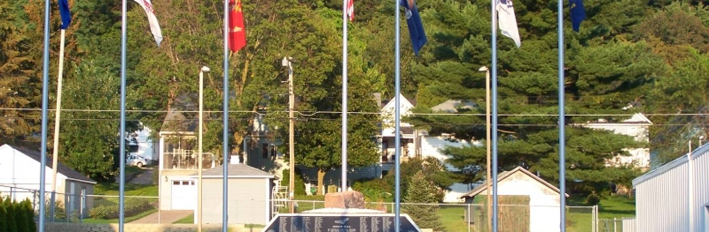 Flags fly above Wonewoc on a calm summer day.