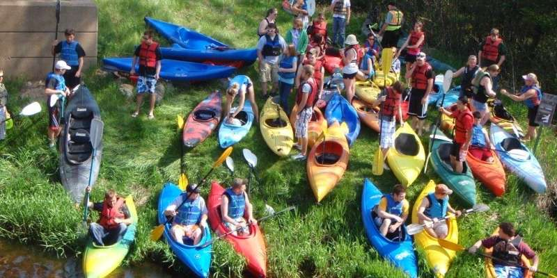 Excited visitors prepare to kayak the Pine River.