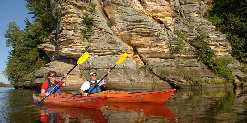 The area's landscape is a breathtaking backdrop for any kayaking adventure.