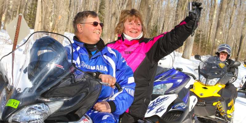 Snowmobilers enjoy one of the area trails.