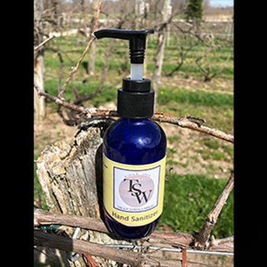 Free bottle of hand sanitizer with case of wine purchase