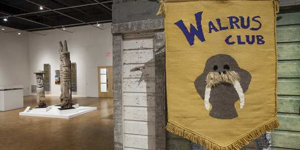 Mary Nohl and the Walrus Club installation view at the John Michael Kohler Arts Center, 2018. Banner: Maggie Sasso, The Walrus Club Banner, 2018; cotton and wood; 39 x 30 x 1/2 in.