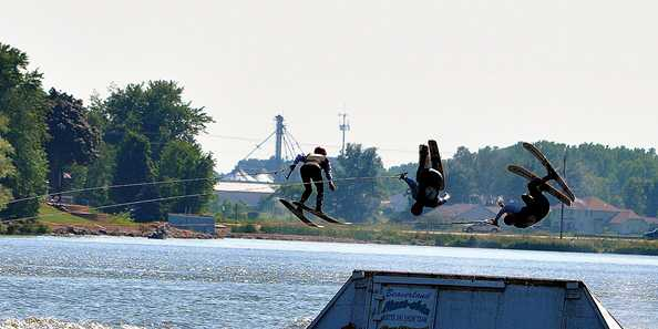 Skiiers perform flips during the 2013 Lake Days celebration.