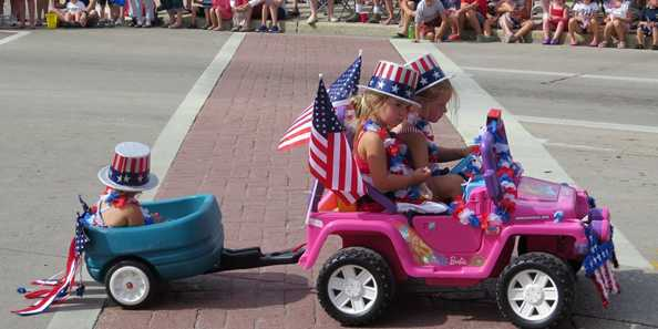 Young and old get into the patriotic spirit for the City of Oconomowoc's annual Fourth of July parade.