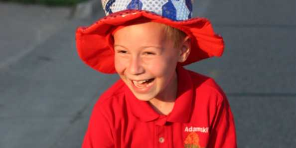 A youngster handing out candy at the 4th of July parade was all smiles! Photo by Antigo/Langlade Chamber of Commerce.