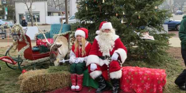 Santa with one of his elves and reindeer.