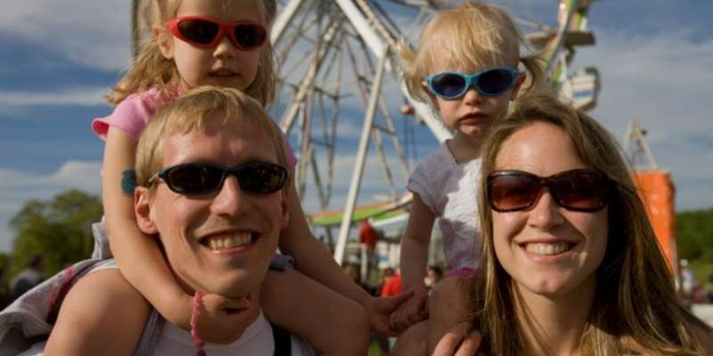 Family by the ferris wheel.