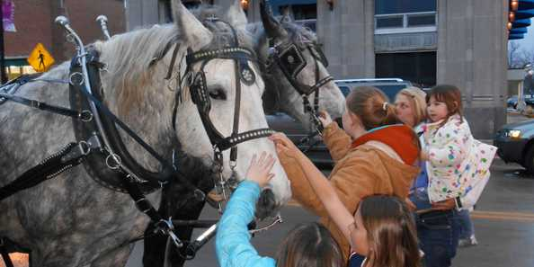 Free horse and buggy rides are a hit for the kids during Spring Gallery Night.