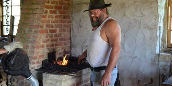 Greg Winz fires up the forge for Blacksmithing