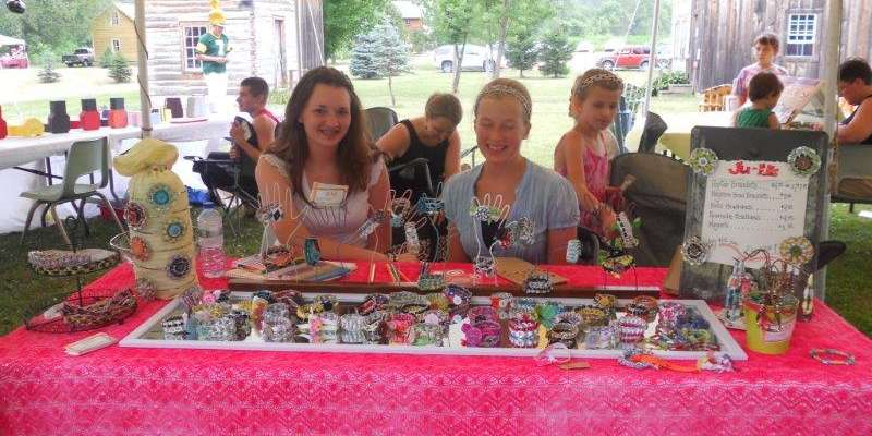 Come to to kid's tent, where youth are selling their art!