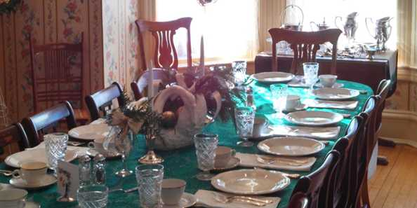 The dining room all set for the Christmas luncheon.