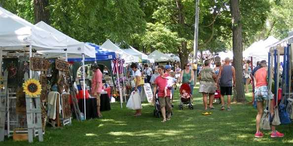 The trees of historic Swan Park provide nice shade for the Art in the Park Arts and Craft Fair