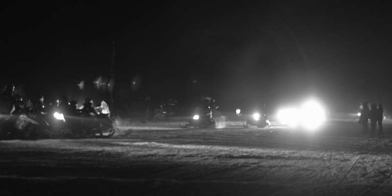Lighted Parade of Snowmobiles