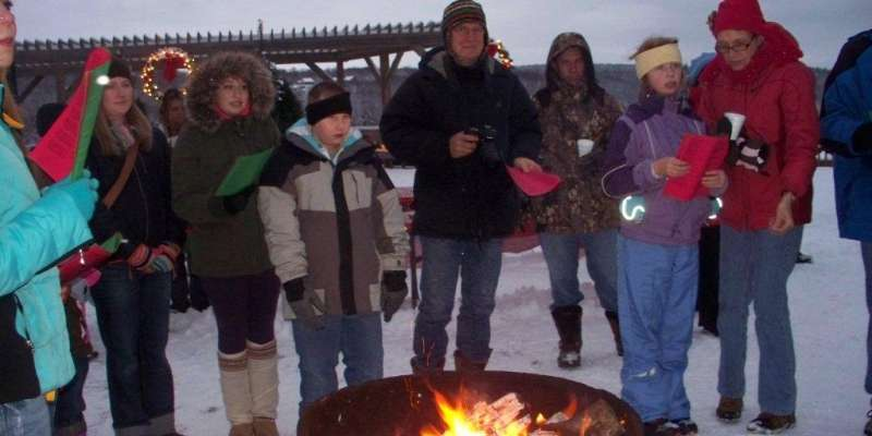 Carolers around the fire pit