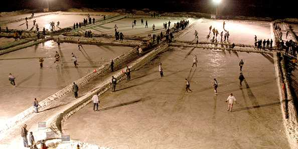 Participants at the Great Lakes Pond Hockey tournament take to the ice.