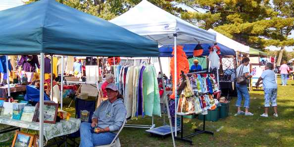 Browse the many booths of hand-crafted items in the Artisans & Crafters Show at Crooked Lake Park.