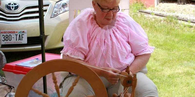 Spinning wool at the Lost Arts Fest